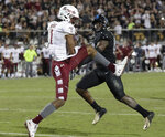 Temple wide receiver Ventell Bryant (1) catches a 15-yard touchdown pass in front of Central Florida linebacker Eric Mitchell during the first half of an NCAA college football game Thursday, Nov. 1, 2018, in Orlando, Fla. (AP Photo/John Raoux)
