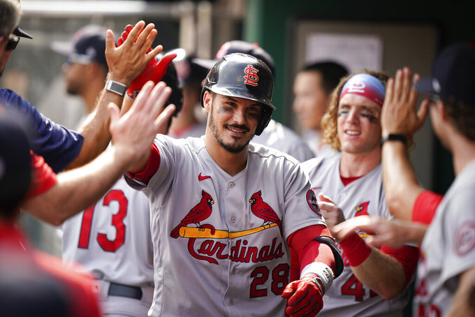 St. Louis Cardinals' third baseman Nolan Arenado (28) celebrates with teammates after hitting a home run during the ninth inning of a baseball game against the Cincinnati Reds in Cincinnati, Sunday, July 25, 2021. (AP Photo/Bryan Woolston)