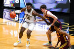 Purdue forward Trevion Williams (50) drives on Minnesota center Liam Robbins (0) during the first half of an NCAA college basketball game in West Lafayette, Ind., Saturday, Jan. 30, 2021. (AP Photo/Michael Conroy)