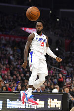Los Angeles Clippers guard Patrick Beverley passes the ball during the first half of the team's NBA basketball game against the Miami Heat Wednesday, Feb. 5, 2020, in Los Angeles. (AP Photo/Mark J. Terrill)