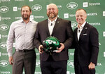 The new New York Jets general manager Joe Douglas, center, poses for a picture with head coach Adam Gase, left, and owner Christopher Johnson during a news conference at the team's NFL football training facility in Florham Park, N.J., Tuesday, June 11, 2019. (AP Photo/Seth Wenig)