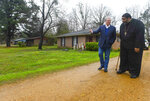 Former Vice President Al Gore, founder of the Climate Reality Project, left, and the Rev. William Barber II, leader of the Moral Mondays movement, visit Lowndes County residents with failing wastewater sanitation systems Thursday, Feb. 21, 2019, in Hayneville, Ala. (AP Photo/Julie Bennett)