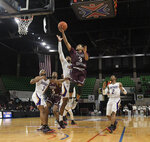 Texas Southern guard Jalyn Patterson (3) scores two against Prairie View A&M during the first half of the SWAC championship NCAA college basketball game Saturday, March 16, 2019, in Birmingham, Ala. (AP Photo/Julie Bennett)