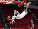North Carolina State's Jericole Hellems dunks against Boston College during the first half of an NCAA college basketball game in Raleigh, N.C., Wednesday, Dec. 30, 2020. (Ethan Hyman/The News & Observer via AP, Pool)