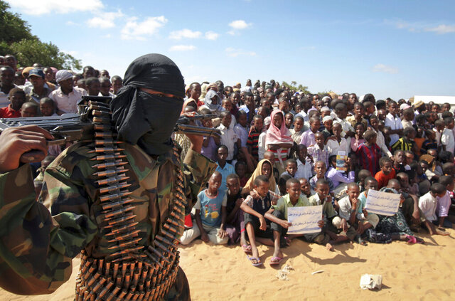 FILE - In this Feb. 13, 2012, file photo, an armed member of the militant group al-Shabab attends a rally on the outskirts of Mogadishu, Somalia. An American military airstrike in Somalia more than a year ago killed two civilians and injured three others, U.S. Africa Command is acknowledging in a new report expected on Monday, April 27, 2020. (AP Photo, File)