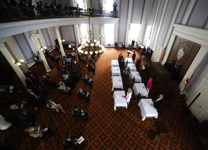 Alabama's nine members of the Electoral College stand in the old House chamber at the Alabama Capitol before casting their votes for President Donald Trump on Monday, Dec. 14, 2020, in Montgomery, Ala. (AP Photo/Jay Reeves)