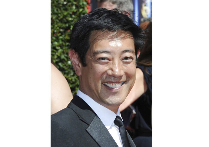 FILE - In this Aug. 16, 2014 file photo, Grant Imahara arrives at the Creative Arts Emmys in Los Angeles. Discovery Channel says the longtime