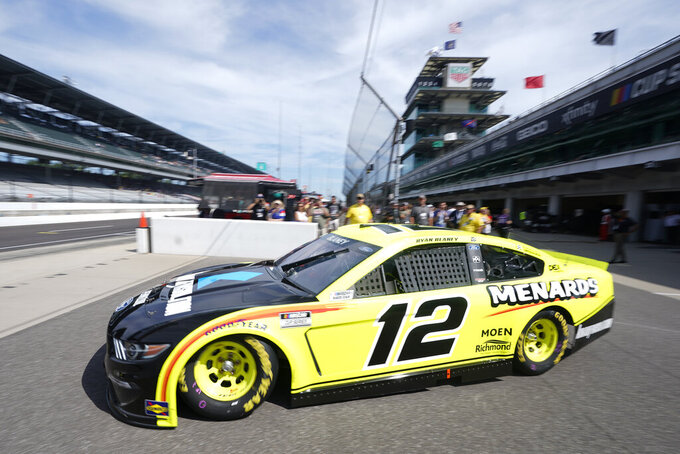 Ryan Blaney pulls out of the garage area during practice for the NASCAR Cup Series at Indianapolis Motor Speedway, Saturday, Aug. 14, 2021, in Indianapolis. (AP Photo/Darron Cummings)