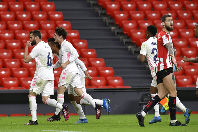 Real Madrid's Nacho, left, celebrate his side goal with his fellow teammate team during Spanish La Liga soccer match between Athletic Bilbao and Real Madrid at San Mames stadium, in Bilbao, northern Spain, Sunday, May 16, 2021. (AP Photo/Alvaro Barrientos)