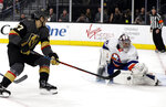 Vegas Golden Knights left wing Max Pacioretty (67) shoots as New York Islanders goalie Semyon Varlamov defends during the second period of an NHL hockey game Saturday, Feb. 15, 2020, in Las Vegas. (AP Photo/Isaac Brekken)