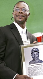 FILE - In this June 28, 2008, file photo, former Toronto Blue Jays player Tony Fernández attends the Canadian Baseball Hall of Fame & Museum ceremony in St. Marys, Ontario. Fernández, a stylish shortstop who made five All-Star teams during his 17 seasons in the major leagues and helped the Toronto Blue Jays win the 1993 World Series, died Sunday after complications from a kidney disease. He was 57. (Ken Wightman/London Free Press via Canadian Press via AP, File)
