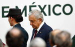 Mexican President Andrés Manuel López Obrador arrives to give his first year's state of the nation address at the National Palace in Mexico City, Sunday, Sept. 1, 2019. (AP Photo/Marco Ugarte)