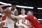 Wisconsin's Aleem Ford, left, grabs a rebound against Nebraska's Thorir Thorbjarnarson during the second half of an NCAA college basketball game in the quarterfinals of the Big Ten Conference tournament, Friday, March 15, 2019, in Chicago. (AP Photo/Kiichiro Sato)
