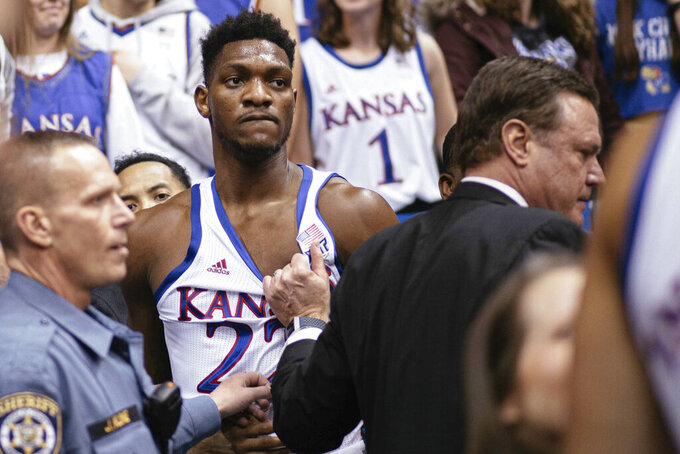 Kansas forward Silvio De Sousa (22) and coach Bill Self stand on court side following a brawl in the second half of an NCAA college basketball game against Kansas State, Jan. 21, 2020 in Lawrence, Kan. (Emma Pravecek/University Daily Kansan via AP)