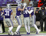 Kansas State defensive back Brock Monty (24) is congratulated by teammates after blocking a punt during the second half of an NCAA college football game against Texas Tech in Manhattan, Kan., Saturday, Nov. 17, 2018. (AP Photo/Orlin Wagner)
