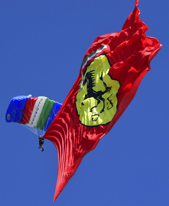 FILE - The Ferrari flag is unfurled during a display prior to the Formula One Grand Prix of Tuscany, at the Mugello circuit in Scarperia, Italy, in this Sunday, Sept. 13, 2020, file photo. Despite the challenges, the top auto manufacturers still see motorsports as an effective marketing tool for their cars. (Jennifer Lorenzini, Pool via AP)