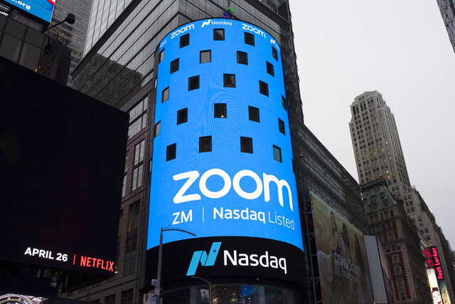 FILE - This April 18, 2019, file photo shows a sign for Zoom Video Communications ahead Nasdaq IPO in New York.  Video app company Zoom said Thursday, June 11 2020, it regretted that some meetings involving U.S.-based Chinese dissidents were disrupted, as meanwhile a prominent Hong Kong activist said his account was blocked despite the city's guarantees of free speech. (AP Photo/Mark Lennihan, File)
