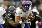 Cincinnati defensive tackle Marquise Copeland (44) sacks East Carolina  quarterback Holton Ahlers (12) in the first quarter of an NCAA college football game, Friday, Nov. 23, 2018, in Cincinnati.   (Kareem Elgazzar/The Cincinnati Enquirer via AP)