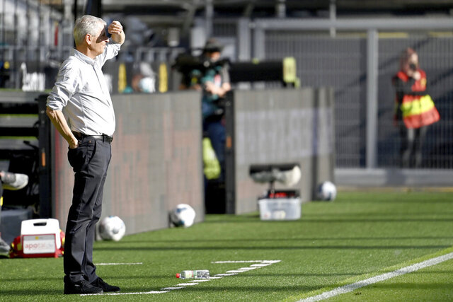 Dortmund's head coach Lucien Favre attends the German Bundesliga soccer match between Borussia Dortmund and FC Bayern Munich in Dortmund, Germany, Tuesday, May 26, 2020. The German Bundesliga is the world's first major soccer league to resume after a two-month suspension because of the coronavirus pandemic. (Federico Gambarini/DPA via AP, Pool)