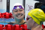 Siobhan Bernadette Haughey, of Hong Kong, reacts after winning the women's 100-meter freestyle semifinal at the 2020 Summer Olympics, Thursday, July 29, 2021, in Tokyo, Japan. (AP Photo/Charlie Riedel)