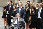 Former Presidents George H.W. Bush and George W. Bush accompanied by their family members watch as pallbearers carry the casket of former first lady Barbara Bush after a funeral service Bush at St. Martin's Episcopal Church, Saturday, April 21, 2018, in Houston. (AP Photo/Evan Vucci)
