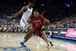 Arizona guard Jemarl Baker Jr., right, drives to the basket around UCLA guard Chris Smith during the first half of an NCAA college basketball game in Los Angeles, Saturday, Feb. 29, 2020. (AP Photo/Chris Carlson)