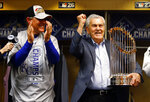 FILE - In this Nov. 2, 2015, file photo, Kansas City Royals owner David Glass, right, and manager Ned Yost celebrate after Game 5 of the Major League Baseball World Series against the New York Mets in New York. Former Walmart Inc. chief executive Glass, who owned the Royals for nearly two decades before selling the franchise last fall, died last week of complications form pneumonia. He was 84. (Al Bello/Pool via AP, File)