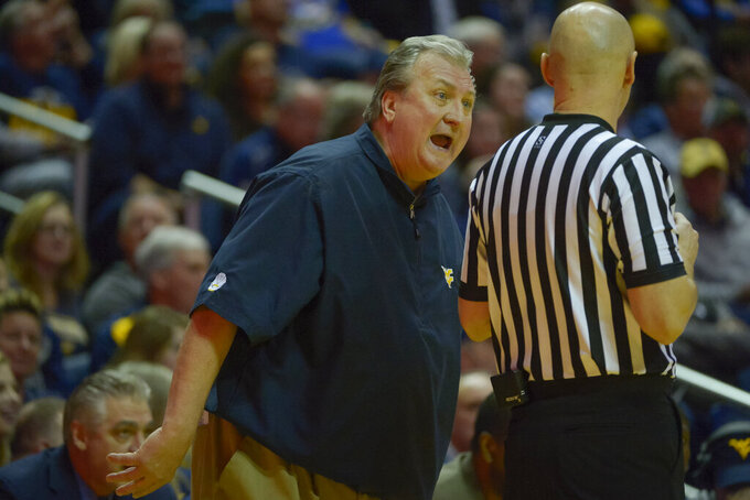 West Virginia Mountaineers head coach Bob Huggins has a dispute with a referee during the first half of an NCAA college basketball game in Morgantown, W.Va. on Saturday Feb. 9, 2019. (AP Photo/Craig Hudson)