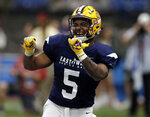 West running back Nick Brossette (5), of LSU, celebrates after catching a touchdown pass against the East during the first half of the East West Shrine college football game Saturday, Jan. 19, 2019, in St. Petersburg, Fla. (AP Photo/Chris O'Meara)