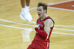 Texas Tech guard Mac McClung celebrates his winning basket in the final seconds of the team's NCAA college basketball game against Texas, Wednesday, Jan. 13, 2021, in Austin, Texas. Texas Tech won 79-77. (AP Photo/Eric Gay)