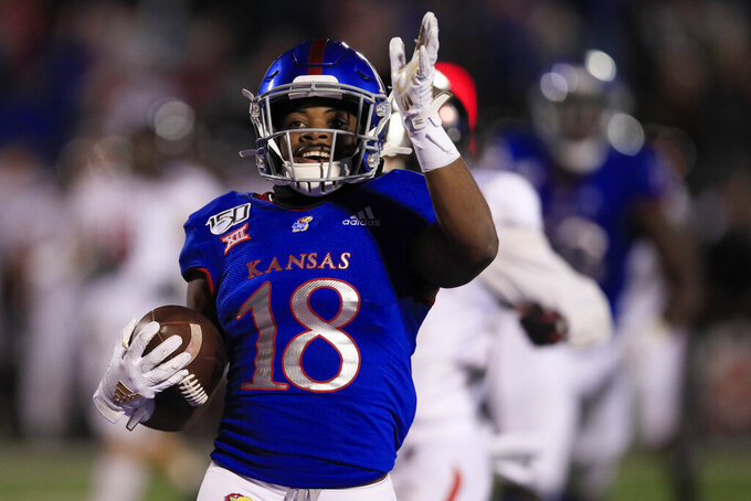 Kansas running back Velton Gardner (18) celebrates as he scores a touchdown during the second half of an NCAA college football game against Texas Tech in Lawrence, Kan., Saturday, Oct. 26, 2019. Kansas defeated Texas Tech 37-34. (AP Photo/Orlin Wagner)