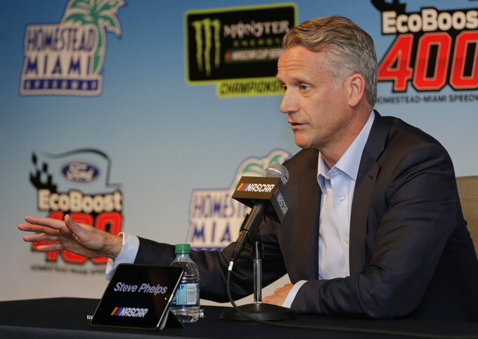 NASCAR President Steve Phelps speaks to the media during a press conference before the NASCAR Cup Series auto race on Sunday, Nov. 17, 2019, at Homestead-Miami Speedway in Homestead, Fla. (AP Photo/Terry Renna)