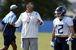 Tennessee Titans head coach Mike Vrabel talks to his players during NFL football training camp Wednesday, July 28, 2021, in Nashville, Tenn. (AP Photo/Mark Zaleski)