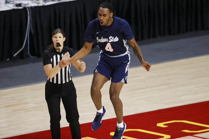 Jackson State guard Tristan Jarrett (4) reacts after missing a shot during the first half of an NCAA college basketball game against Iowa State, Sunday, Dec. 20, 2020, in Ames, Iowa. (AP Photo/Matthew Putney)