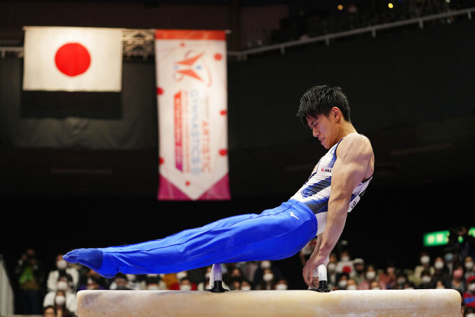 Daiki Hashimoto, of Japan, competes on the pommel horse during the men's all-around finals in the FIG Artistic Gymnastics World Championships in Kitakyushu, western Japan, Friday, Oct. 22, 2021. (AP Photo/Hiro Komae)