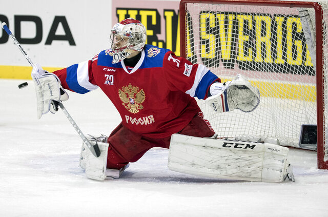 FILE - In this Feb. 11, 2017, file photo, Russia's goalkeeper Ilya Sorokin makes a save during the Sweden Hockey Games at Scandinavium Arena in Goteborg, Sweden. The New York Islanders have signed goaltender of the future Ilya Sorokin to a contract for next season. The $2 million deal includes $1 million in salary and a $1 million bonus. The team signed Sorokin to an entry-level deal Monday, July 13, 2020, for the remainder of this season even though he's not eligible to play. The 24-year-old Sorokin is considered one of the top prospects at any position not current in the NHL. (Bjorn Larsson Rosvall/TT via AP, File)
