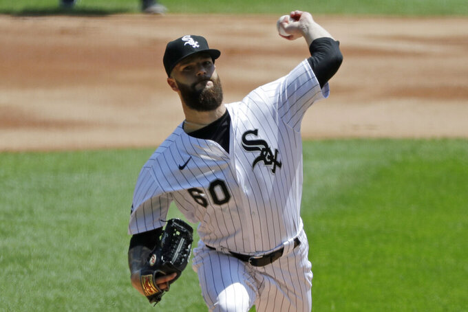Chicago White Sox starting pitcher Dallas Keuchel throws the ball against the Minnesota Twins during the first inning of a baseball game in Chicago, Saturday, July 25, 2020. (AP Photo/Nam Y. Huh)