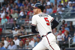 Atlanta Braves' Freddie Freeman watches his RBI single during the first inning of the baseball game against the Washington Nationals on Thursday, Sept. 5, 2019, in Atlanta. (AP Photo/John Bazemore)