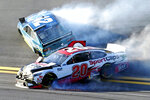 Erik Jones (20) and Kyle Larson (42) wreck going through Turn 4 during the NASCAR Busch Clash auto race at Daytona International Speedway, Sunday, Feb. 9, 2020, in Daytona Beach, Fla. (AP Photo/Darryl Graham)