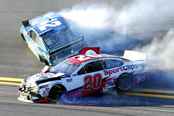 Erik Jones (20) and Kyle Larson (42) wreck going through Turn 4 during the NASCAR Busch Clash auto race at Daytona International Speedway, Sunday, Feb. 9, 2020, in Daytona Beach, Fla. (AP Photo/Darryl Graham)