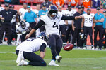 Jacksonville Jaguars kicker Josh Lambo (4) makes a game-winning field goal during the second half of an NFL football game against the Denver Broncos, Sunday, Sept. 29, 2019, in Denver. (AP Photo/Jack Dempsey)
