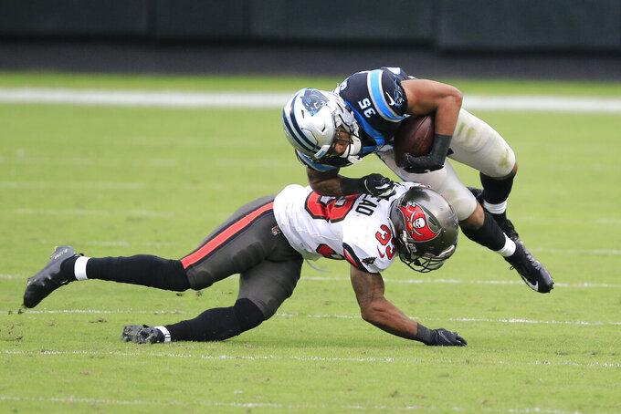 Tampa Bay Buccaneers free safety Jordan Whitehead (33) hits Carolina Panthers Corrion Ballard (35) during the second half of an NFL football game, Sunday, Nov. 15, 2020, in Charlotte , N.C. (AP Photo/Brian Blanco)