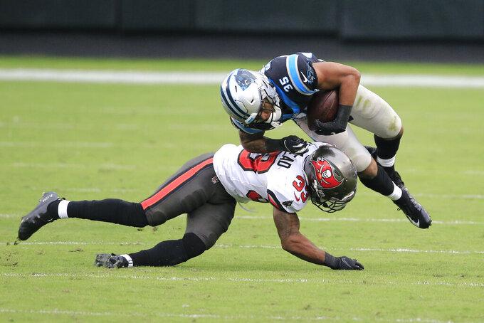 Tampa Bay Buccaneers free safety Jordan Whitehead (33) hits Carolina Panthers Corrion Ballard (35) during the second half of an NFL football game, Sunday, Nov. 15, 2020, in Charlotte , N.C. (AP Photo/Brian Blanco)