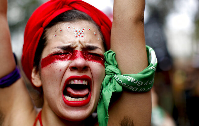 A woman shouts slogans as she marches to Congress to commemorate International Women's Day in Buenos Aires, Argentina, Monday, March 9, 2020. (AP Photo/Natacha Pisarenko)