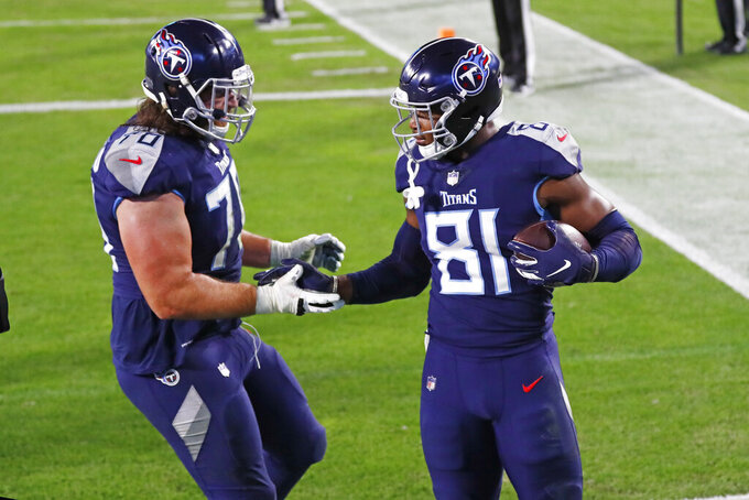 Tennessee Titans tight end Jonnu Smith (81) celebrates with offensive tackle Ty Sambrailo (70) after Smith scored a touchdown against the Indianapolis Colts in the first half of an NFL football game Thursday, Nov. 12, 2020, in Nashville, Tenn. (AP Photo/Wade Payne)