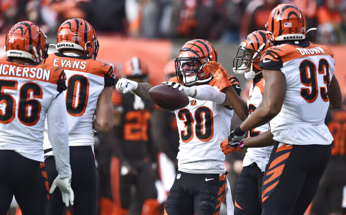 Cincinnati Bengals free safety Jessie Bates (30) celebrates with teammates after an interception during the first half of an NFL football game against the Cleveland Browns, Sunday, Dec. 8, 2019, in Cleveland. (AP Photo/David Richard)