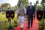 Indian Defense Minister Rajnath Singh, left, walks with his Australian counterpart Peter Dutton during a Guard of Honor for the latter in New Delhi, India, Friday, Sept. 10, 2021. (AP Photo/Altaf Qadri)