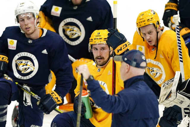 Nashville Predators left wing Filip Forsberg (9) listens to head coach John Hynes during NHL hockey training camp Monday, Jan. 4, 2021, in Nashville, Tenn. (AP Photo/Mark Humphrey)