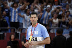 Argentine fans cheer as Luis Scola of Argentina stands with his medal during the silver-medal ceremony after their loss to Spain in their first-place match in the FIBA Basketball World Cup at the Cadillac Arena in Beijing, Sunday, Sept. 15, 2019. (AP Photo/Mark Schiefelbein)