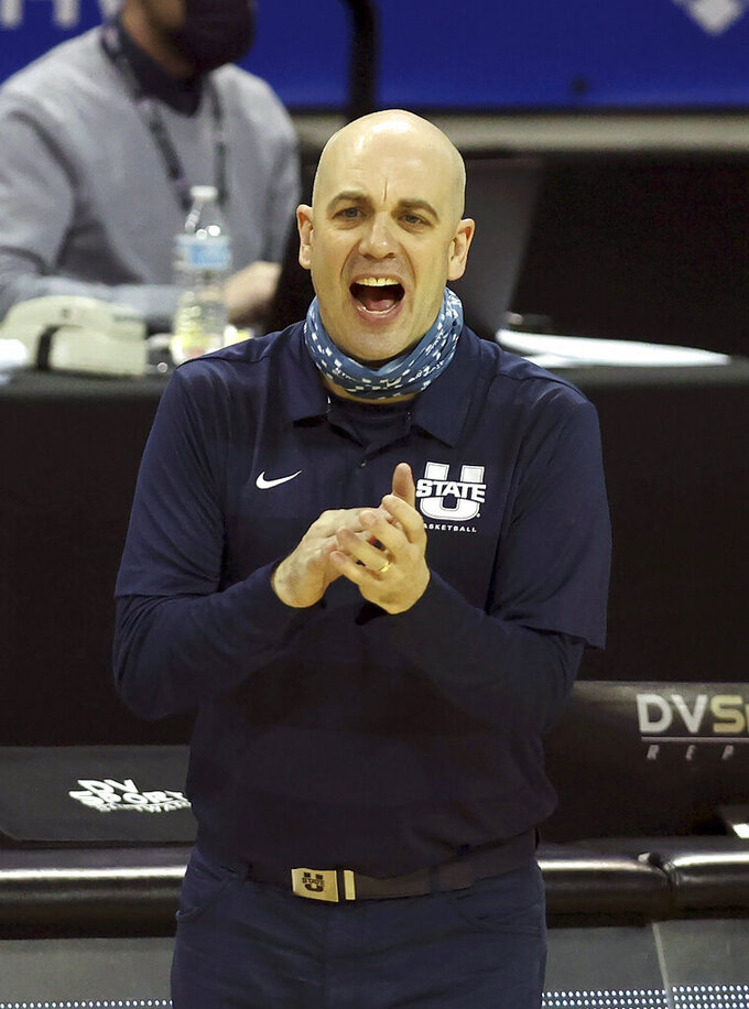 Utah State head coach Craig Smith reacts to a basket during the second half of an NCAA college basketball game against Colorado State in the semifinal round of the Mountain West Conference men's tournament Friday, March 12, 2021, in Las Vegas. (AP Photo/Isaac Brekken)